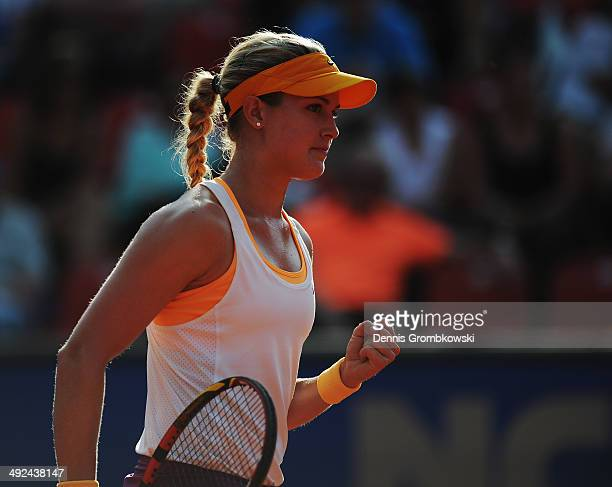Eugenie Bouchard of Canada celebrates a point during her match against Anastasia Rodionova of Australia during Day 4 of the Nuernberger...