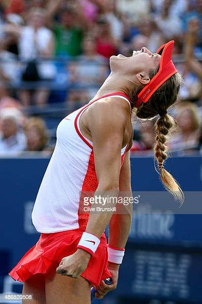 Eugenie Bouchard of Canada celebrates after defeating Dominika Cibulkova of Slovakia during their Women's Singles Third Round match on Day Five of...