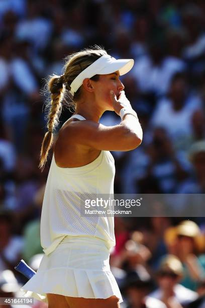 Eugenie Bouchard of Canada celebrates after winning her Ladies' Singles semi-final match against Simona Halep of Romania on day ten of the Wimbledon...