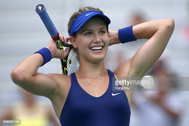 Eugenie Bouchard of Canada celebrates after winning her match against Alize Cornet of France on day five of the 2014 Dongfeng Motor Wuhan Open at...