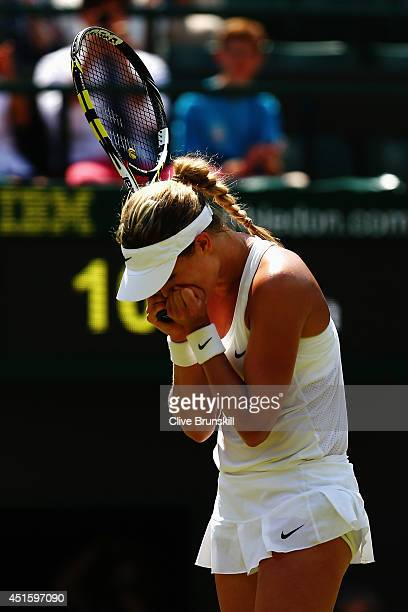 Eugenie Bouchard of Canada celebrates match point and winning her Ladies' Singles quarterfinal match against Angelique Kerber of Germany on day nine...