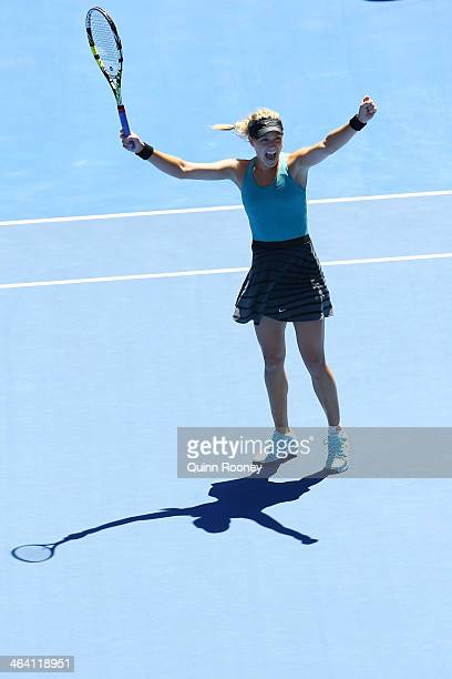 Eugenie Bouchard of Canada celebrates winning her quarterfinal match against Ana Ivanovic of Serbia during day nine of the 2014 Australian Open at...