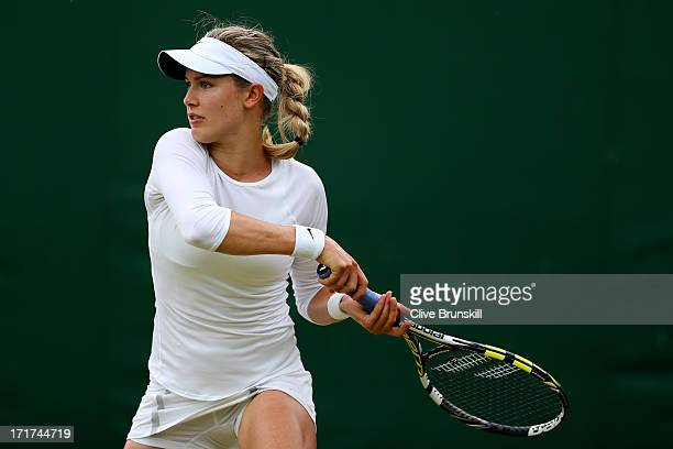Eugenie Bouchard of Canada hits a forehand during her Ladies' Singles third round match against Carla Suarez Navarro of Spain on day five of the...