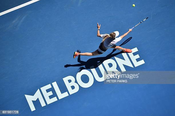 Eugenie Bouchard of Canada hits a return against Peng Shuai of China in their women's singles match on day three of the Australian Open tennis...