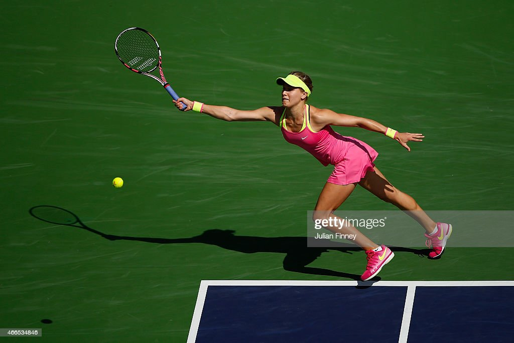 Eugenie Bouchard of Canada in action against Coco Vandeweghe of USA during day eight of the BNP Paribas Open tennis at the Indian Wells Tennis Garden on March 16, 2015 in Indian Wells, California.