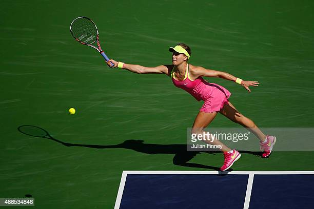 Eugenie Bouchard of Canada in action against Coco Vandeweghe of USA during day eight of the BNP Paribas Open tennis at the Indian Wells Tennis Garden...