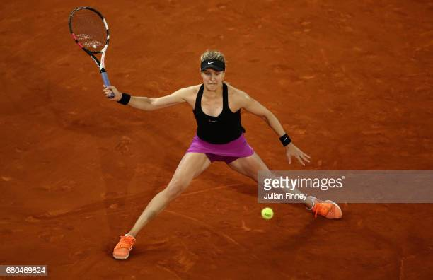 Eugenie Bouchard of Canada in action against Maria Sharapova of Russia during day three of the Mutua Madrid Open tennis at La Caja Magica on May 8...