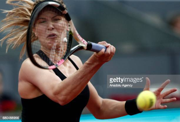 Eugenie Bouchard of Canada in action against Maria Sharapova of Russia during their women's match as part of the Mutua Madrid Open tennis tournament...