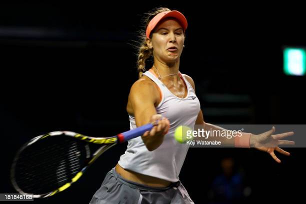 Eugenie Bouchard of Canada in action during her women's singles quarter final match against Venus Williams of the United States during day five of...