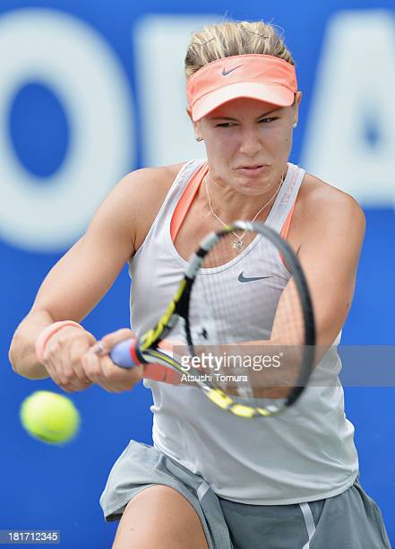 Eugenie Bouchard of Canada in action during her women's singles second round match against Sloane Stephens of the United States during day three of...