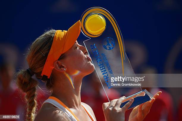 Eugenie Bouchard of Canada kisses the trophy after defeating Karolina Pliskova of Czech Republic during Day 8 of the Nuernberger Versicherungscup on...