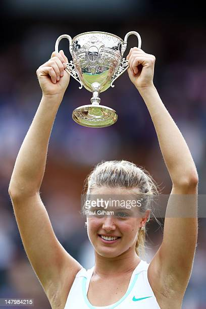 Eugenie Bouchard of Canada lifts the winners trophy after winning her Girls' Singles final match against Elina Svitolina of Ukraine on day twelve of...