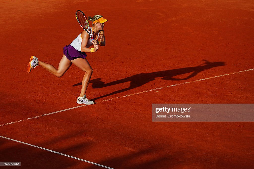Eugenie Bouchard of Canada plays a backhand in her match against Yaroslava Shvedova of Kazakhstan during Day 6 of the Nuernberger Versicherungscup on May 22, 2014 in Nuremberg, Germany.