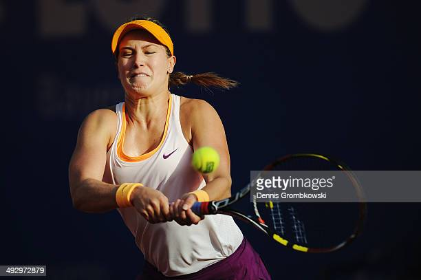 Eugenie Bouchard of Canada plays a backhand in her match against Yaroslava Shvedova of Kazakhstan during Day 6 of the Nuernberger Versicherungscup on...