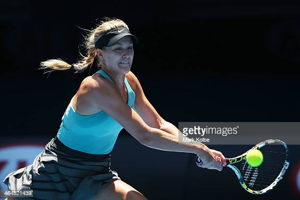 Eugenie Bouchard of Canada plays a backhand in her semifinal match against Na Li of China during day 11 of the 2014 Australian Open at Melbourne Park...