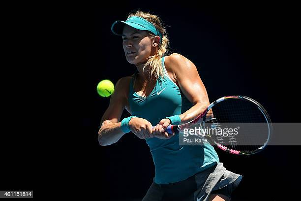 Eugenie Bouchard of Canada plays a backhand in her singles match against Flavia Pennetta of Italy during day five of the 2015 Hopman Cup at Perth...