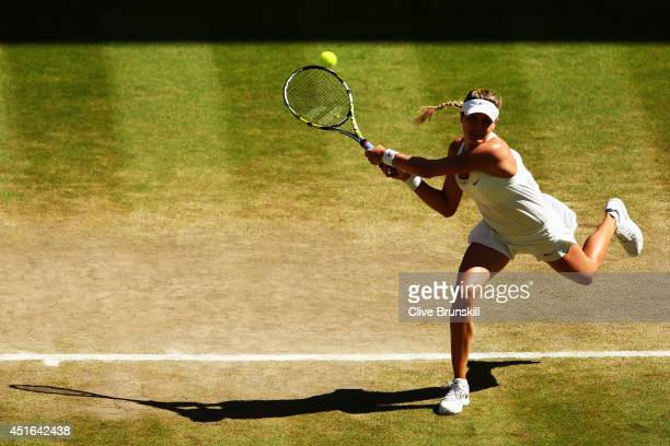 Eugenie Bouchard of Canada plays a backhand return during her Ladies' Singles semifinal match against Simona Halep of Romania on day ten of the...
