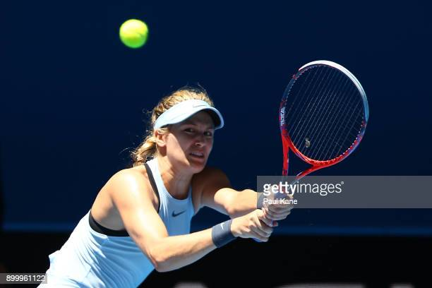 Eugenie Bouchard of Canada plays a backhand to Daria Gavrilova of Australia in her singles match on day 2 of the 2018 Hopman Cup at Perth Arena on...