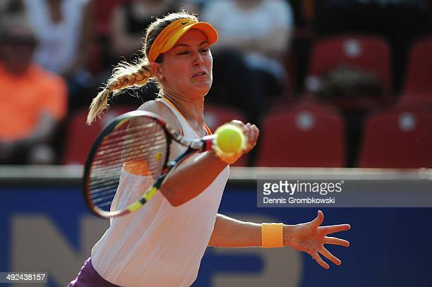 Eugenie Bouchard of Canada plays a forehand during her match against Anastasia Rodionova of Australia during Day 4 of the Nuernberger...