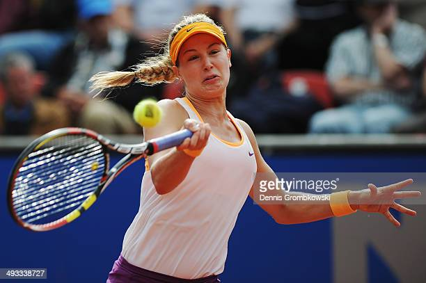 Eugenie Bouchard of Canada plays a forehand during her match against Karin Knapp of Italy during Day 7 of the Nuernberger Versicherungscup on May 23...