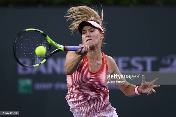 Eugenie Bouchard of Canada plays a forehand in her match against Risa Ozaki of Japan during day four of the BNP Paribas Open at Indian Wells Tennis...