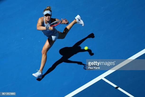 Eugenie Bouchard of Canada plays a forehand in her singles match against Elise Mertens of Belgium on day seven during the 2018 Hopman Cup at Perth...