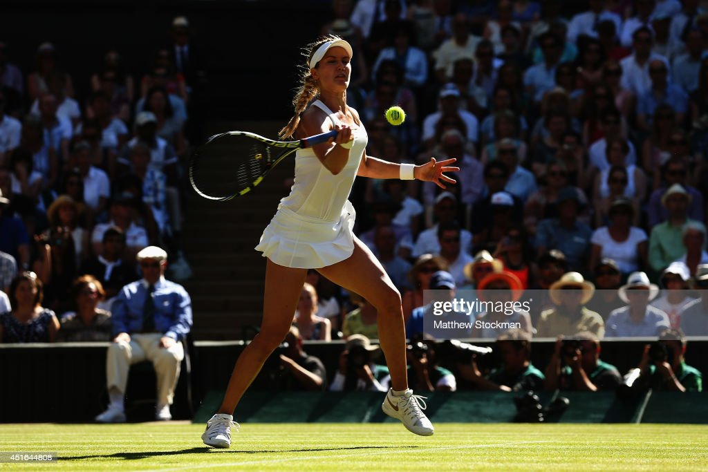 Eugenie Bouchard of Canada plays a forehand return during her Ladies' Singles semi-final match against Simona Halep of Romania on day ten of the Wimbledon Lawn Tennis Championships at the All England Lawn Tennis and Croquet Club on July 3, 2014 in London, England.