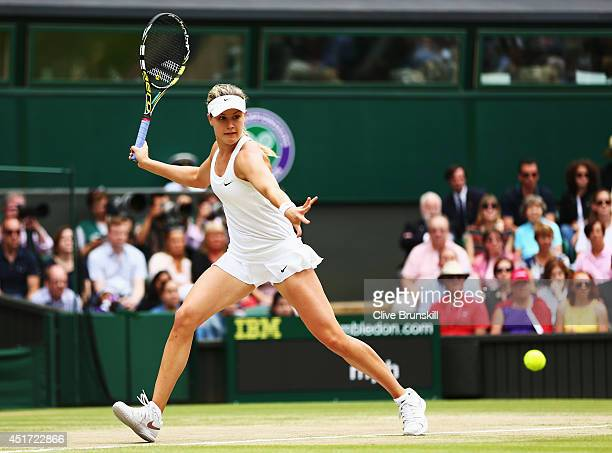 Eugenie Bouchard of Canada plays a forehand return during the Ladies' Singles final match against Petra Kvitova of Czech Republic on day twelve of...