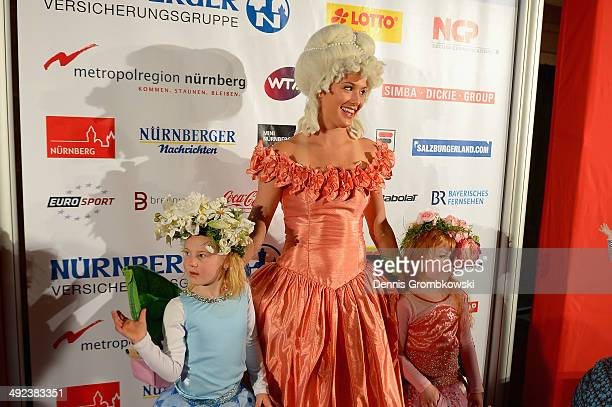 Eugenie Bouchard of Canada poses in a traditional Baroque dress as she arrives for the Player's Party during Day 3 of the Nuernberger...
