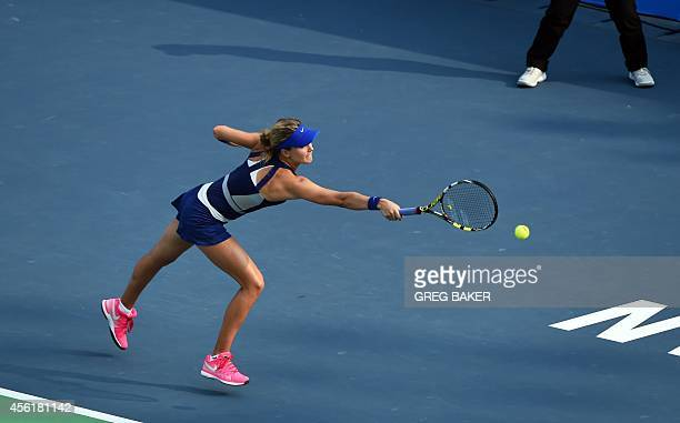 Eugenie Bouchard of Canada reaches for a return to Petra Kvitova of the Czech Republic during the final of the Wuhan Open tennis tournament in Wuhan...