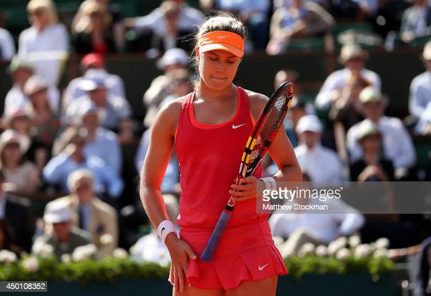 Eugenie Bouchard of Canada reacts during her women's singles semi-final match against Maria Sharapova of Russia on day twelve of the French Open at...