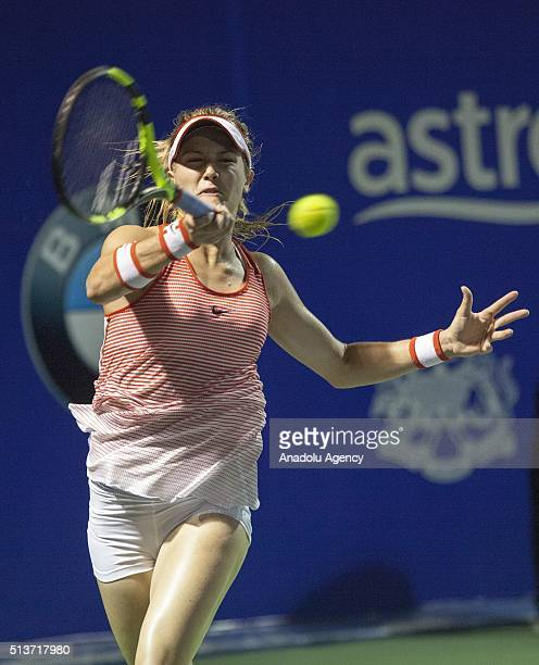 Eugenie Bouchard of Canada returns a ball to Cagla Buyukakcay of Turkey during a match in the women's singles tennis tournament of the WTA BMW...