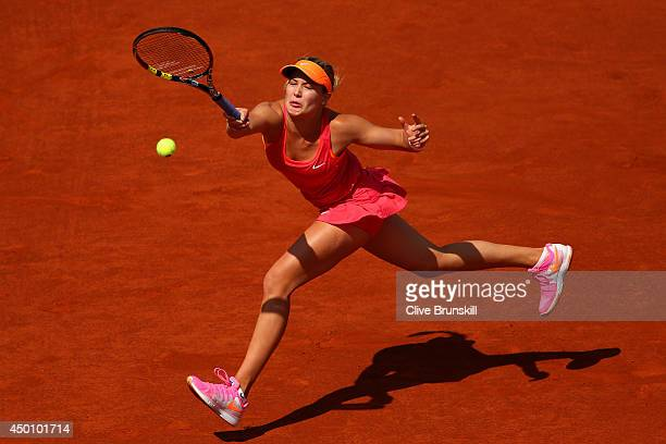 Eugenie Bouchard of Canada returns a shot during her women's singles semifinal match against Maria Sharapova of Russia on day twelve of the French...
