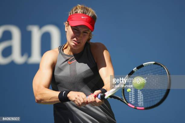 Eugenie Bouchard of Canada returns a shot to Evgeniya Rodina of Russia during their first round Women's Singles match on Day Three of the 2017 US...