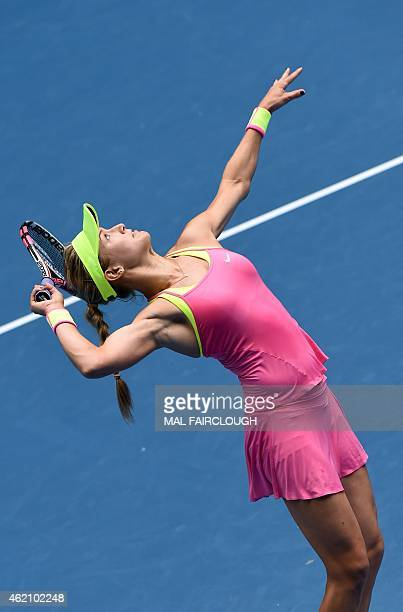 Eugenie Bouchard of Canada serves against Irina-Camelia Begu of Romania in their women's singles match on day seven of the 2015 Australian Open...