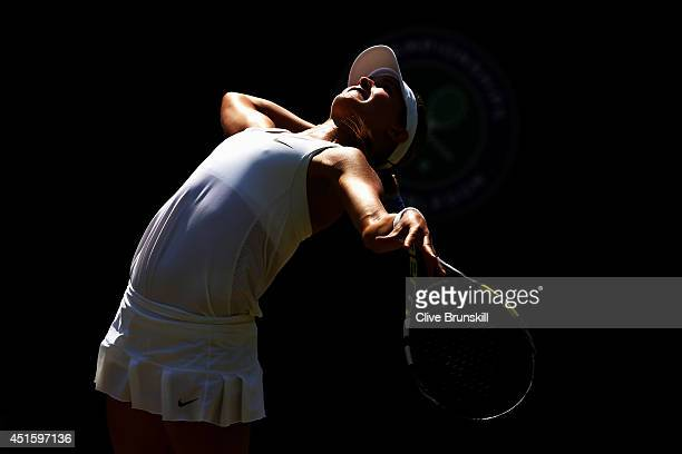 Eugenie Bouchard of Canada serves during her Ladies' Singles quarter-final match against Angelique Kerber of Germany on day nine of the Wimbledon...