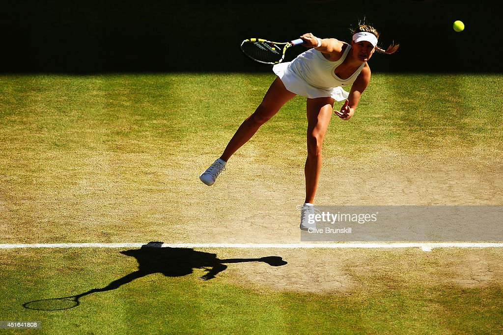 Eugenie Bouchard of Canada serves during her Ladies' Singles semi-final match against Simona Halep of Romania on day ten of the Wimbledon Lawn Tennis Championships at the All England Lawn Tennis and Croquet Club on July 3, 2014 in London, England.