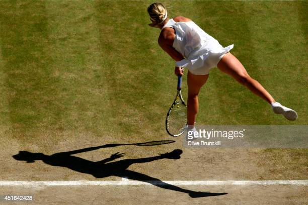 Eugenie Bouchard of Canada serves during her Ladies' Singles semifinal match against Simona Halep of Romania on day ten of the Wimbledon Lawn Tennis...