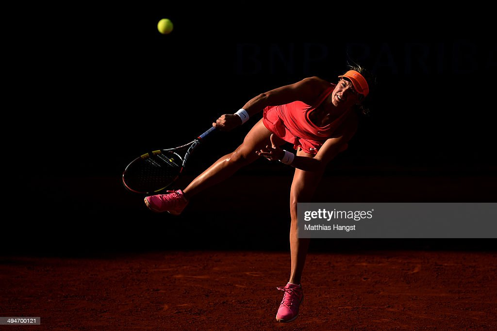 Eugenie Bouchard of Canada serves during her women's singles match against Johanna Larsson of Sweden on day six of the French Open at Roland Garros on May 30, 2014 in Paris, France.