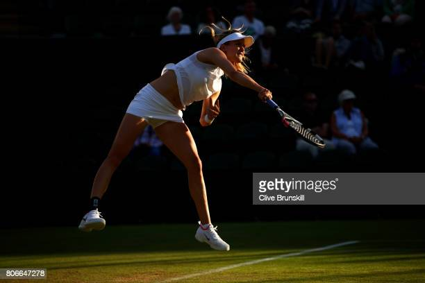 Eugenie Bouchard of Canada serves during the Ladies Singles first round match against Carla Suarez Navarro of Spain on day one of the Wimbledon Lawn...