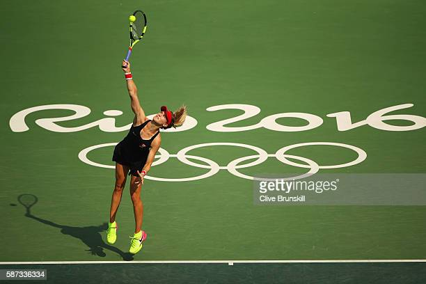 Eugenie Bouchard of Canada serves during the Women's Singles second round match against Angelique Kerber of Germany on Day 3 of the Rio 2016 Olympic...