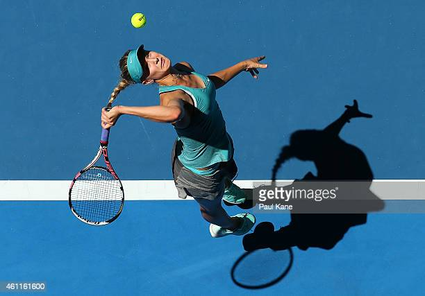 Eugenie Bouchard of Canada serves in the mixed doubles match partnered with Vasek Pospisil against Fabio Fognini and Flavia Pennetta of Italy during...
