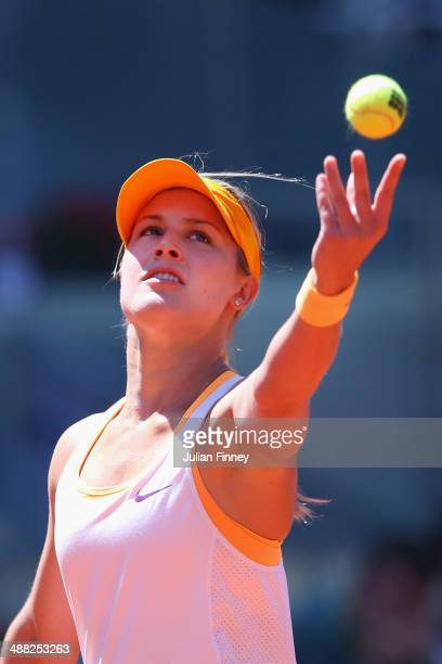 Eugenie Bouchard of Canada serves to Agnieszka Radwanska of Poland during day three of the Mutua Madrid Open tennis tournament at the Caja Magica on...