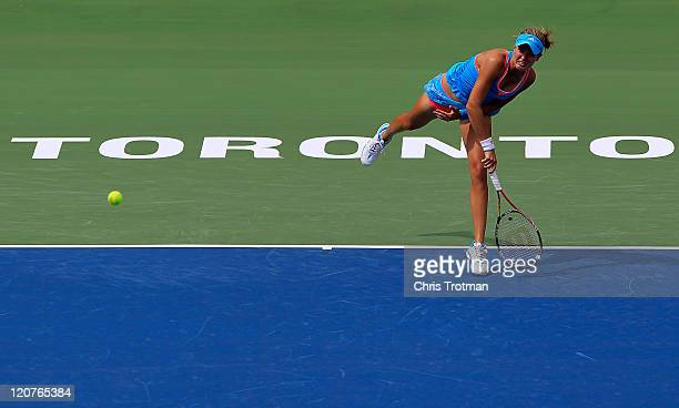 Eugenie Bouchard of Canada serves to Andrea Petkovic of Germany on Day 2 of the Rogers Cup presented by National Bank at the Rexall Centre on August...
