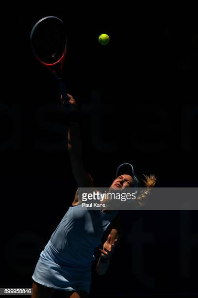 Eugenie Bouchard of Canada serves to Daria Gavrilova of Australia in her singles match on day 2 of the 2018 Hopman Cup at Perth Arena on December 31...