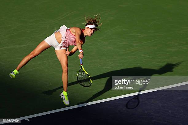 Eugenie Bouchard of Canada serves to Timea Bacsinszky of Switzerland during day eight of the BNP Paribas Open at Indian Wells Tennis Garden on March...