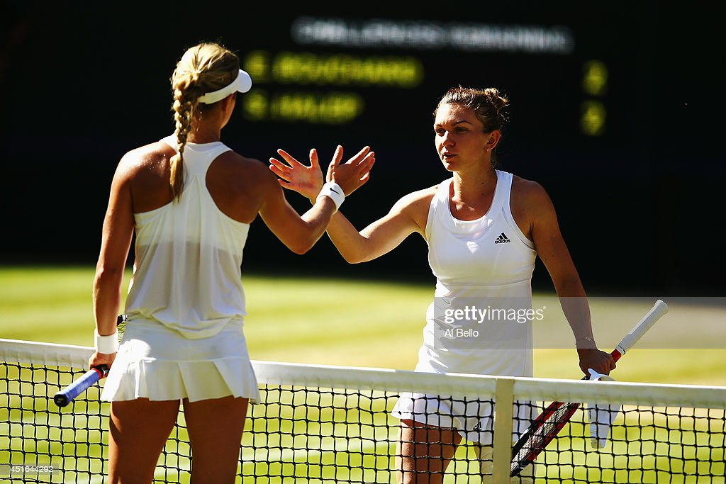 Eugenie Bouchard of Canada shakes hands with Simona Halep of Romania after winning their Ladies' Singles semi-final match on day ten of the Wimbledon Lawn Tennis Championships at the All England Lawn Tennis and Croquet Club on July 3, 2014 in London, England.