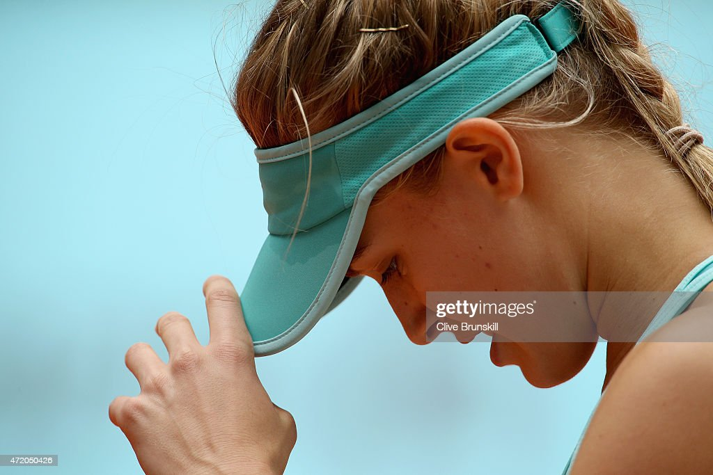 Eugenie Bouchard of Canada shows her dejection during her three set defeat against Barbora Strycova of the Czech Republic in their first round match during day two of the Mutua Madrid Open tennis tournament at the Caja Magica on May 3, 2015 in Madrid, Spain.