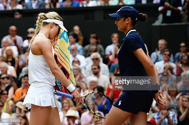 Eugenie Bouchard of Canada stands dejected during the Ladies' Singles final match against Petra Kvitova of Czech Republic on day twelve of the...