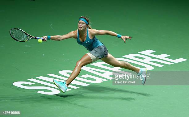 Eugenie Bouchard of Canada stretches to play a forehand against Ana Ivanovic of Serbia in their round robin match during the BNP Paribas WTA Finals...